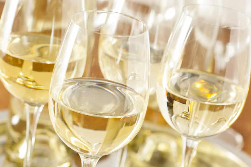 Chardonnay wine glasses glimmering in the sunlight reveals the tr color of the varietal.