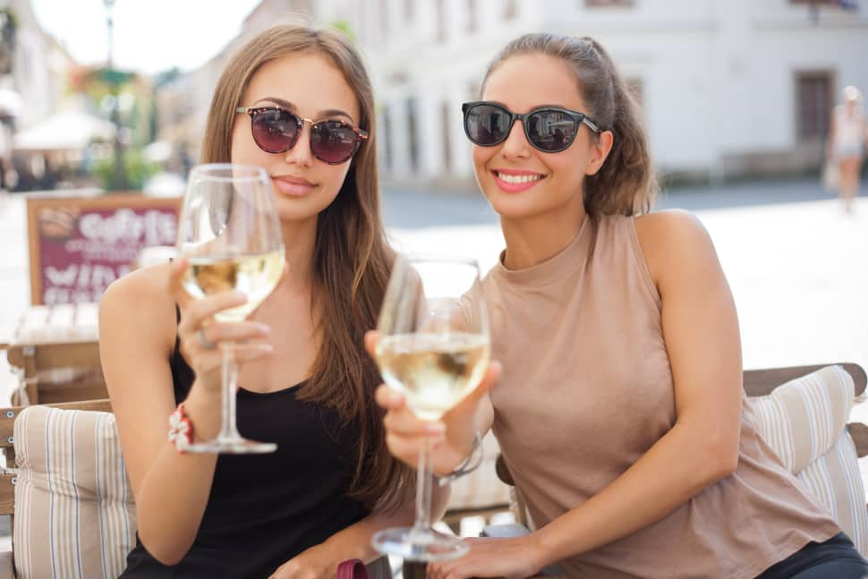 Friends enjoying the new signature Chardonnay from Halleck Vineyard.